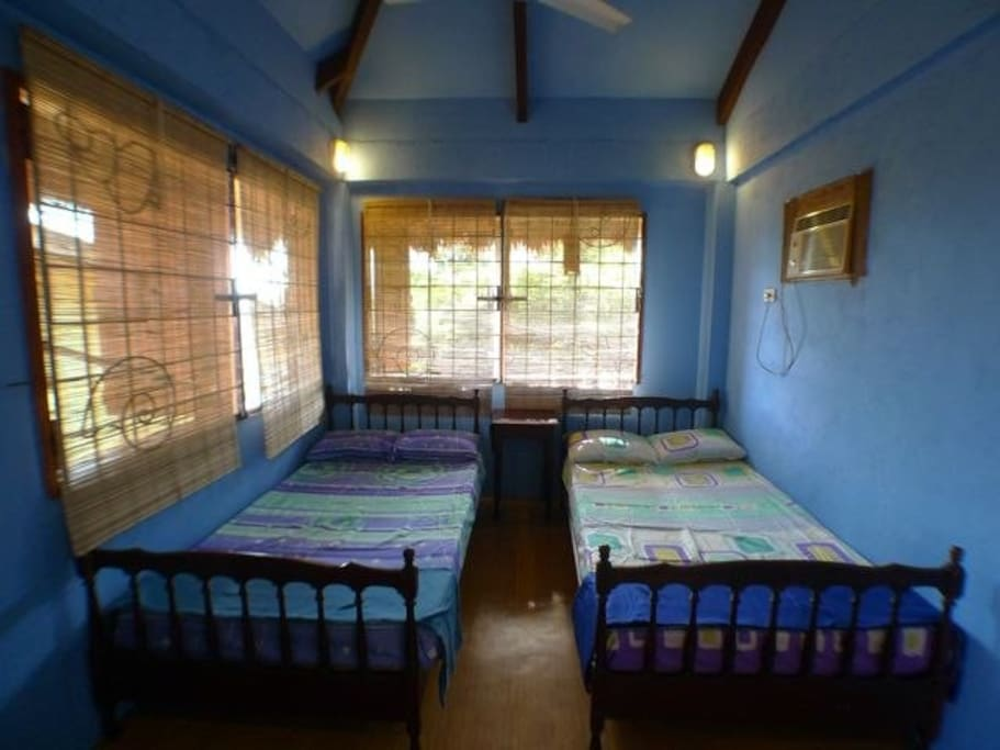 bedroom with 2 double size beds & 2 folding beds with mattresses