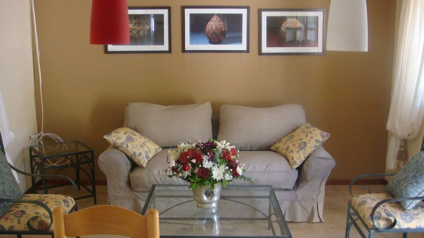 lounge area with many ethnik african pictures