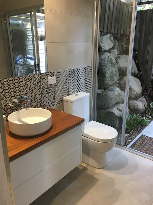 Bathroom with access to private garden