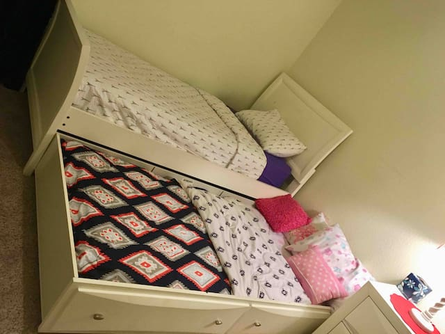 Twin bed with trundle, rooms sleeps two if you use trundle.
