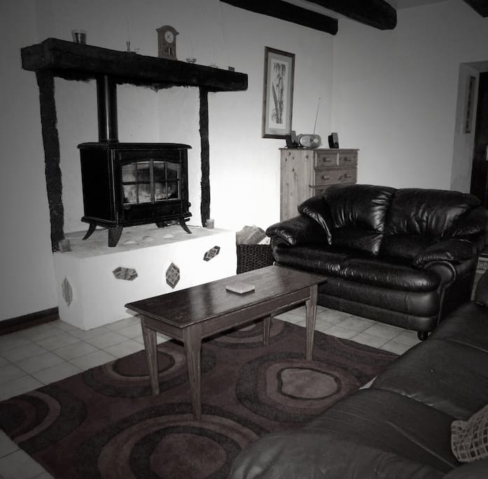 Comfy & cosy lounge with a big classic log burner!