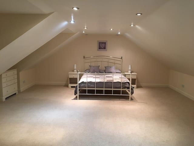 Bedroom one - very spacious makes a great family room, also has the daybed/Sofa the single trundle bed and or travel cot can also be added.