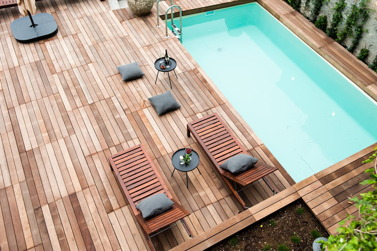 Relax on the pool terrace with deck chairs