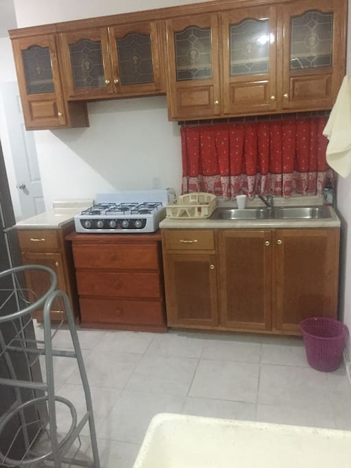 Brand new kitchen with stove and full size refrigerator / freezer