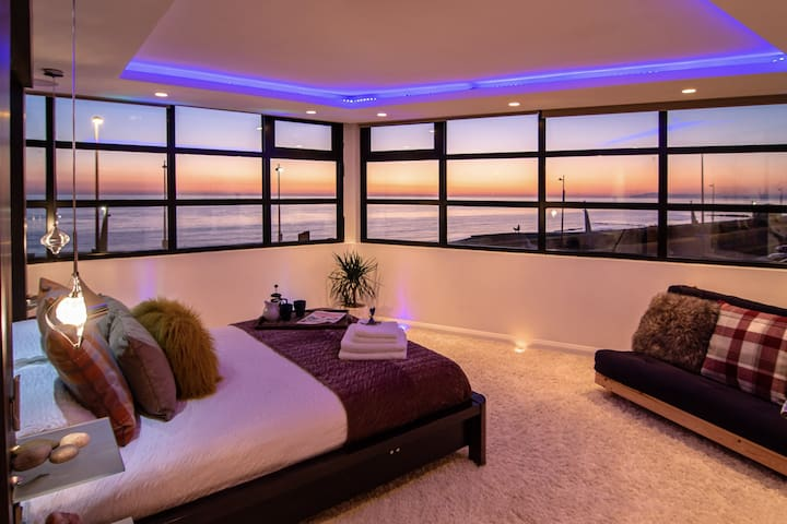 Cosy Master Bedroom with ambient lighting and panoramic sea views