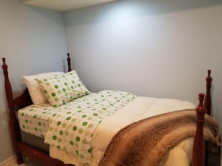 Comfortable bedroom with a twin bed in a basement