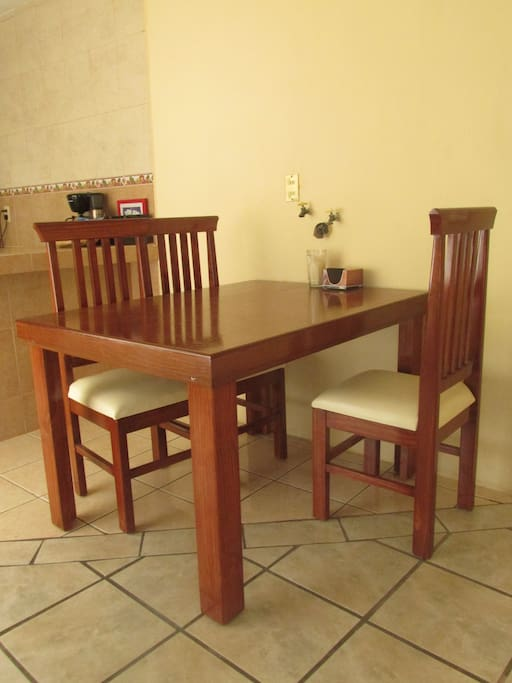 Big dinning table with 4 chairs.