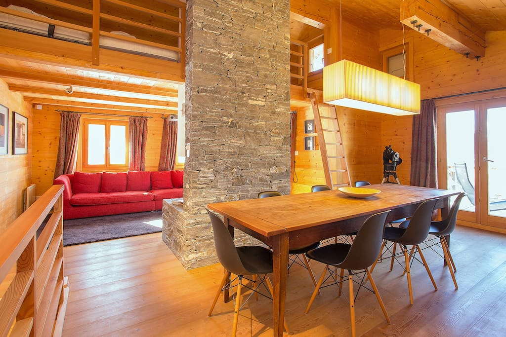 First Floor: Contemporary living & dining room with stone chimney