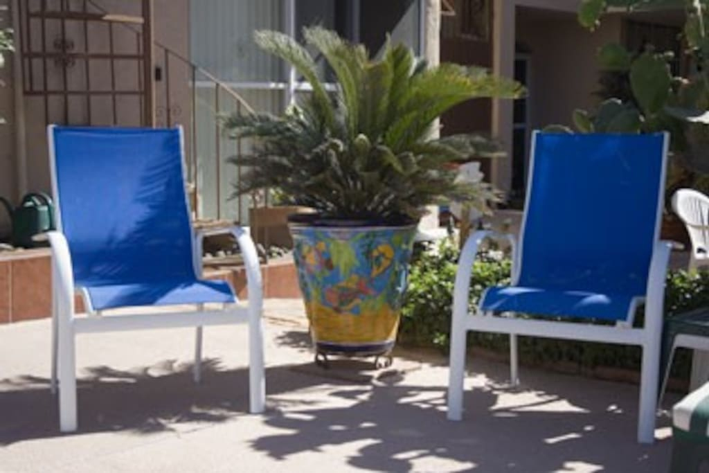 Patio chairs by the pool.