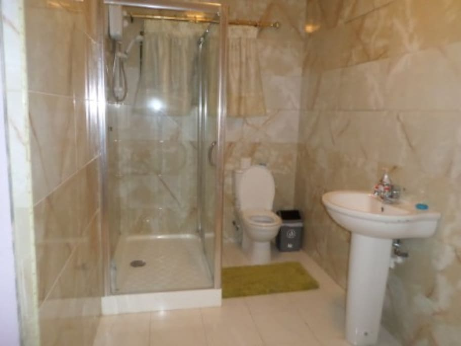 First class bathroom with  water heater installed ..