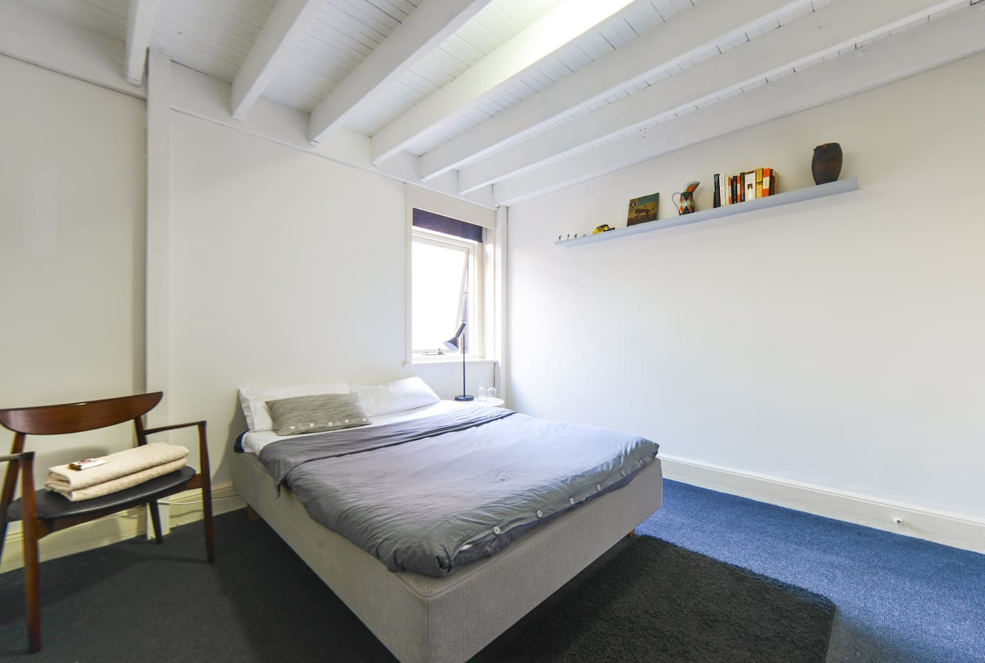 Quiet upstairs room with ultra comfortable double-bed.