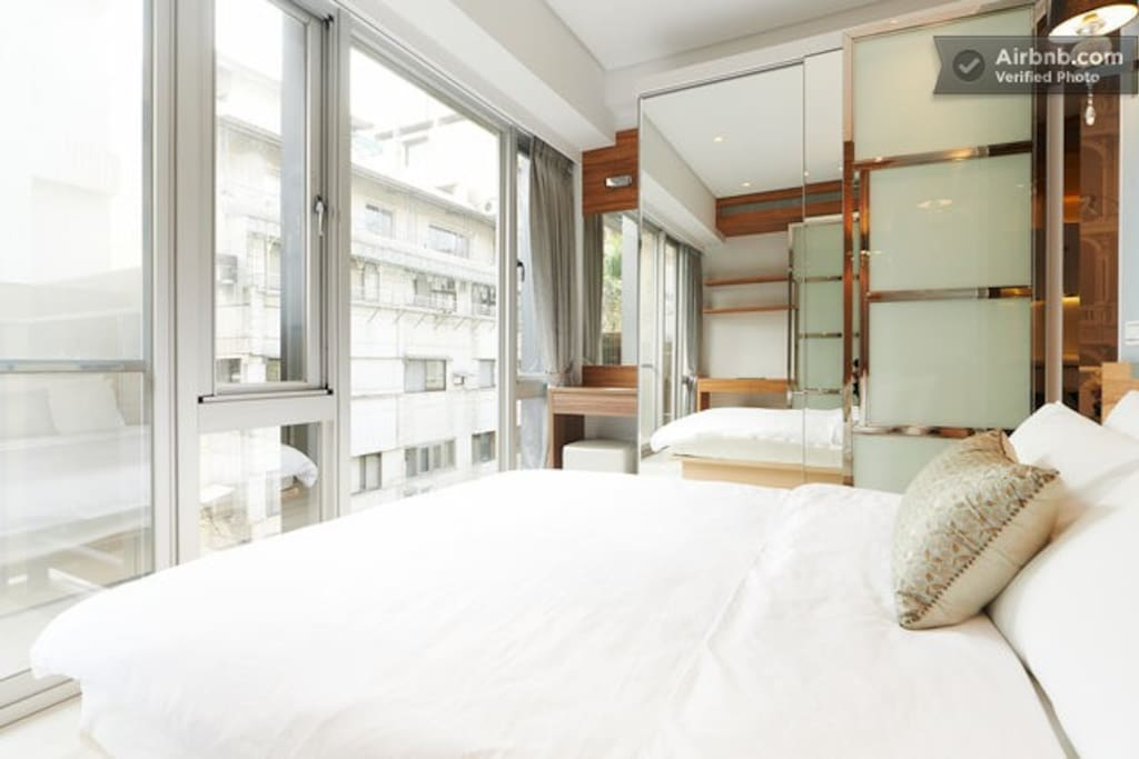 bedroom with full floor to ceiling windows
