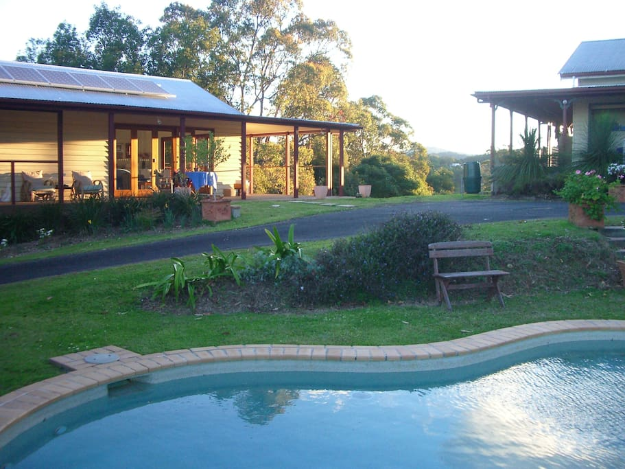 View towards the house from 12m pool. Barracks on the left and Main house on the right.