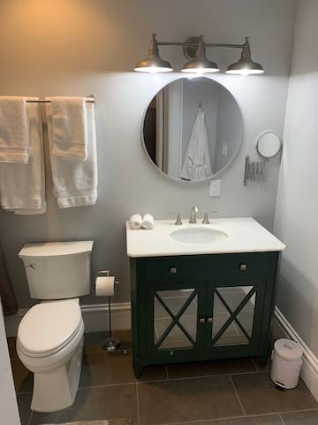 Two robes accompany the bathroom amenities.
