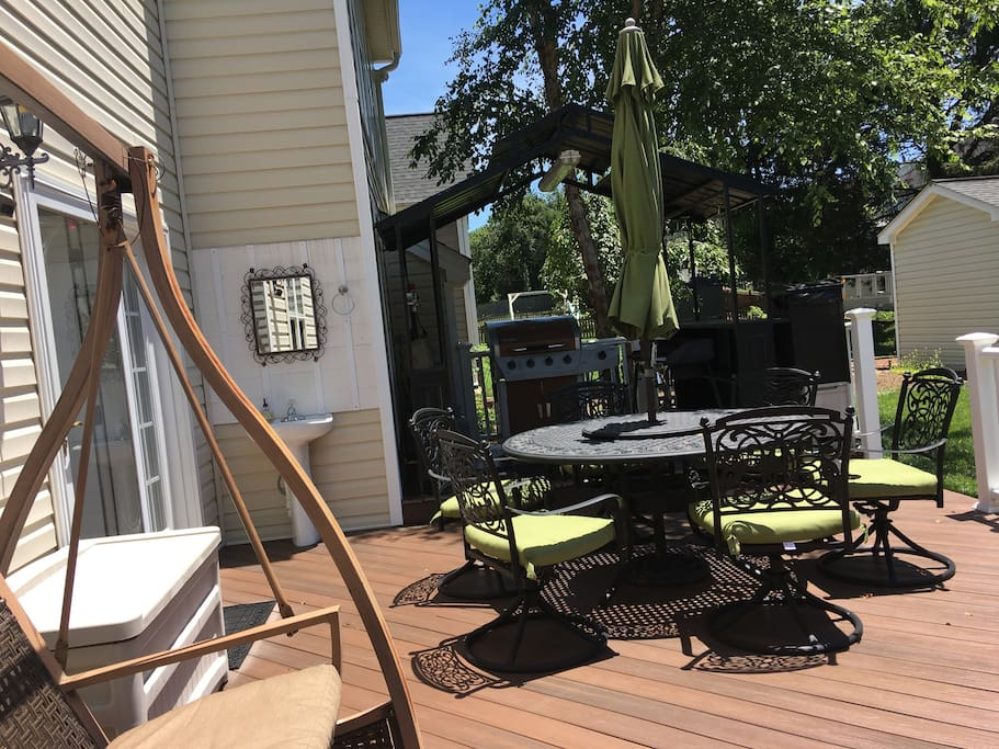 3 people swing set on the deck