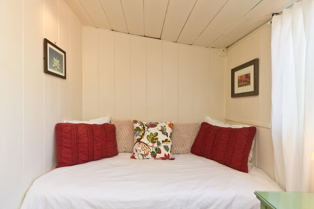 Cozy sleeping nook.  Twin bed.  Very tall people might find this a little too cozy!