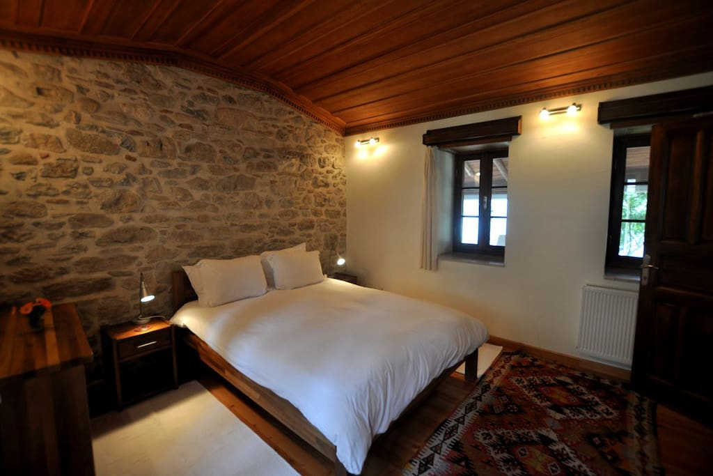 Double bedroom with hand crafted ceiling and furniture