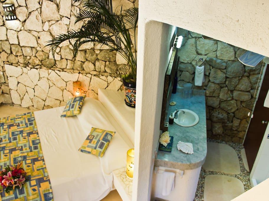 Sinks in bathroom behind the bedroom