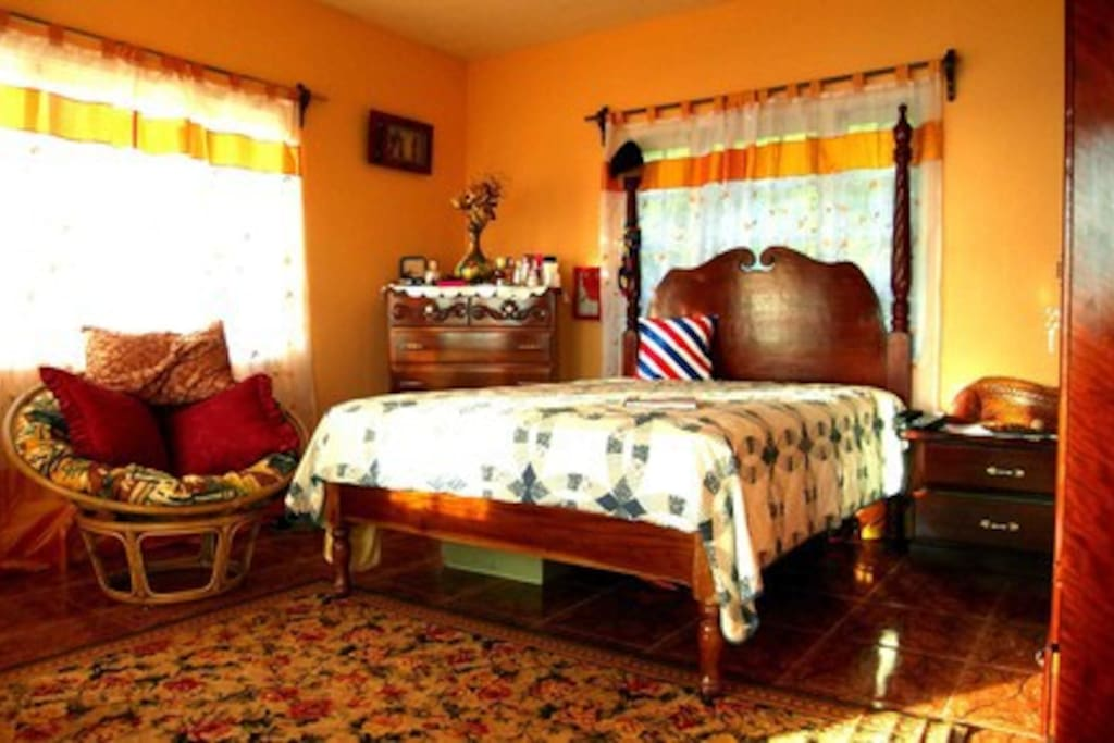 The room with the double bed.
