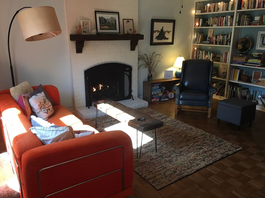 Family room with queen-size pullout couch, gas fireplace,  books, and games