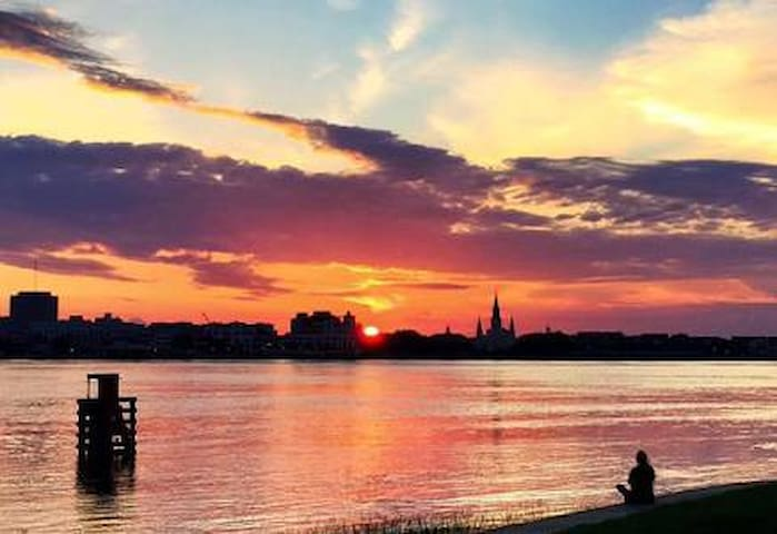 That's why we are called Sunset Point! Walk across the street of your private condo and this is your view at dusk. Algiers Point boasts the best sunsets in the city !