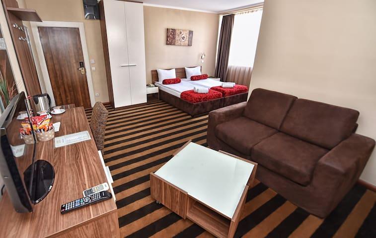 Quadruple room at Balkan Hotel Garni