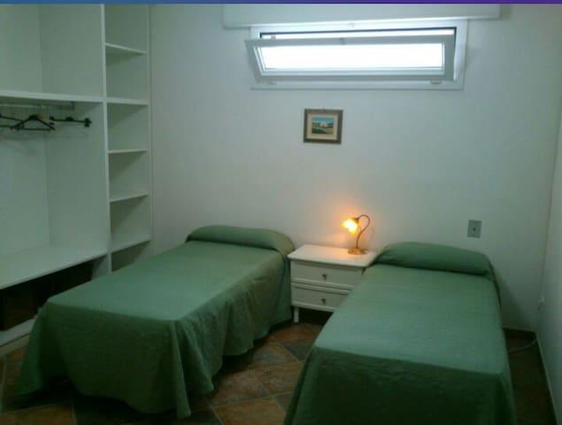 Camera da letto con due letti singoli o letto matrimoniale