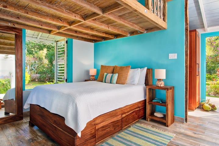 Queen bed in main sleeping area