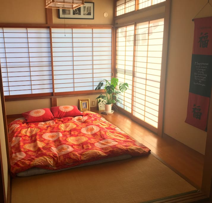 Your A Japanese bedroom ('washitsu' = old-style Japanese room) is a bedroom only by night.  It is designed to be multi-functional.  Furnished with tatami  floor mats and fitted wall closets.