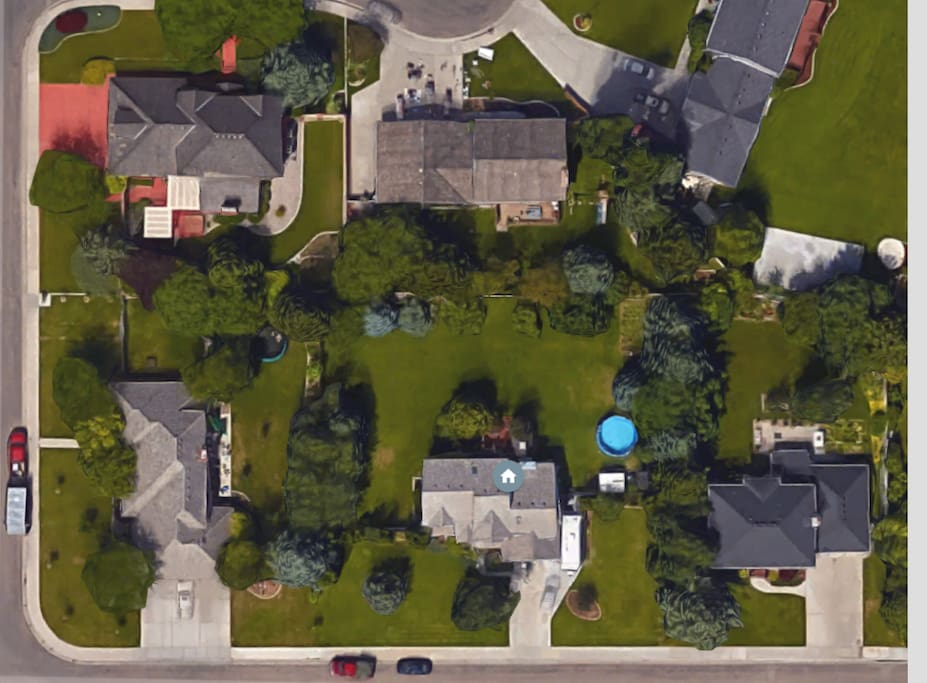 This house is located  in the center of this picture with a huge backyard
