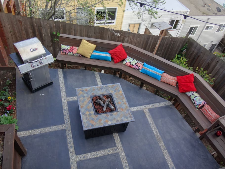 patio with built-in seating, grill and herb garden