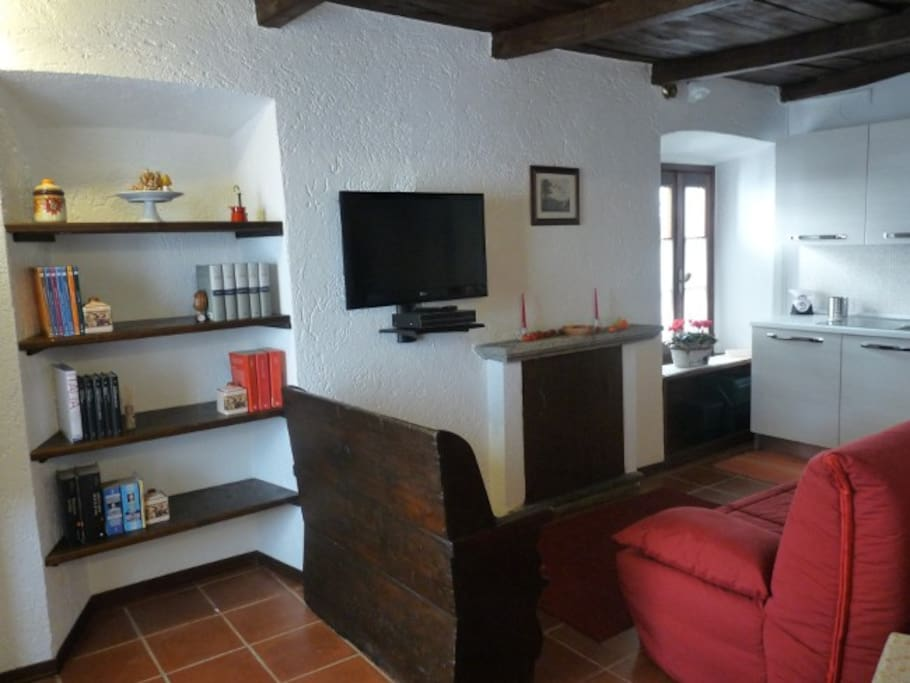 Kitchen/diner/living room with full HD LCD TV, satellite receiver, double sofa bed, table and chairs