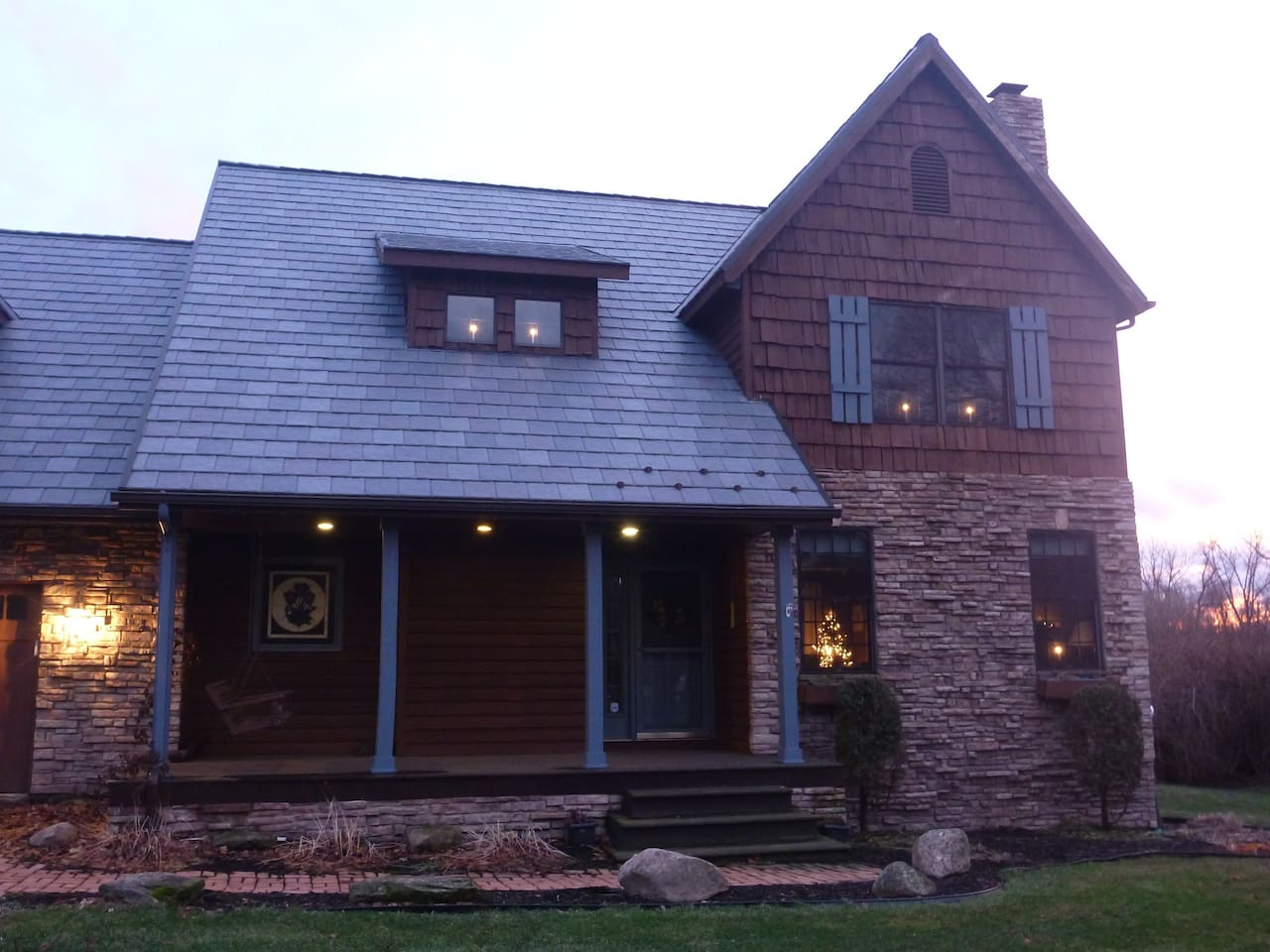 Closeup of front - see porch swing & stained glass window.