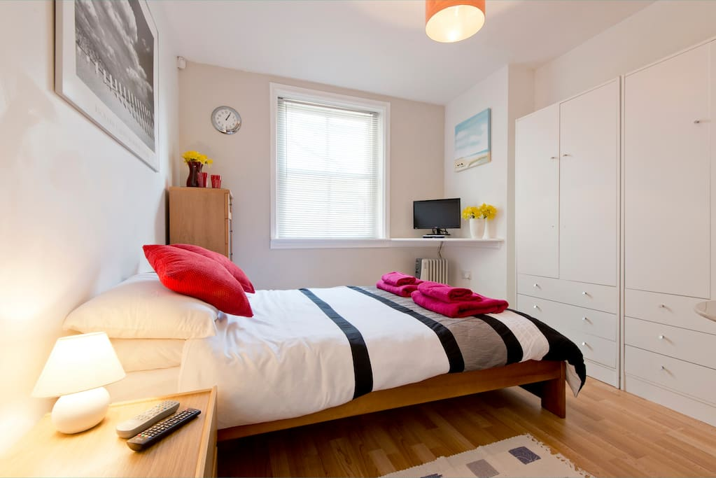 Comfortable double bed, flat screen digital TV and ample storage space
