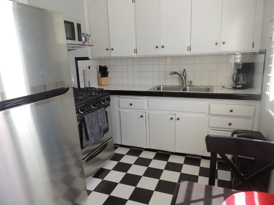 Kitchen with stainless steel appliances lots of tile.  Has everything.