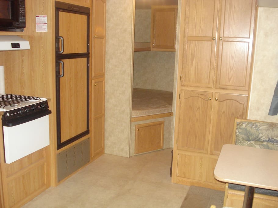 Bedroom 2 in rear left (bunks) and Kitchen area