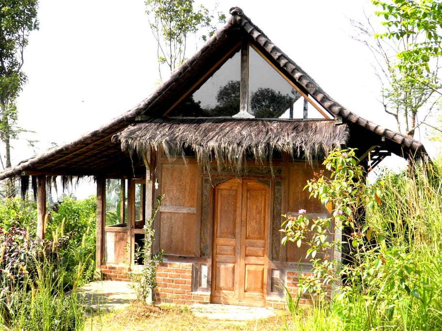 The front entrance and porch of the Imah Guru, the first of our reconstructed teak homes, and one of our favorites