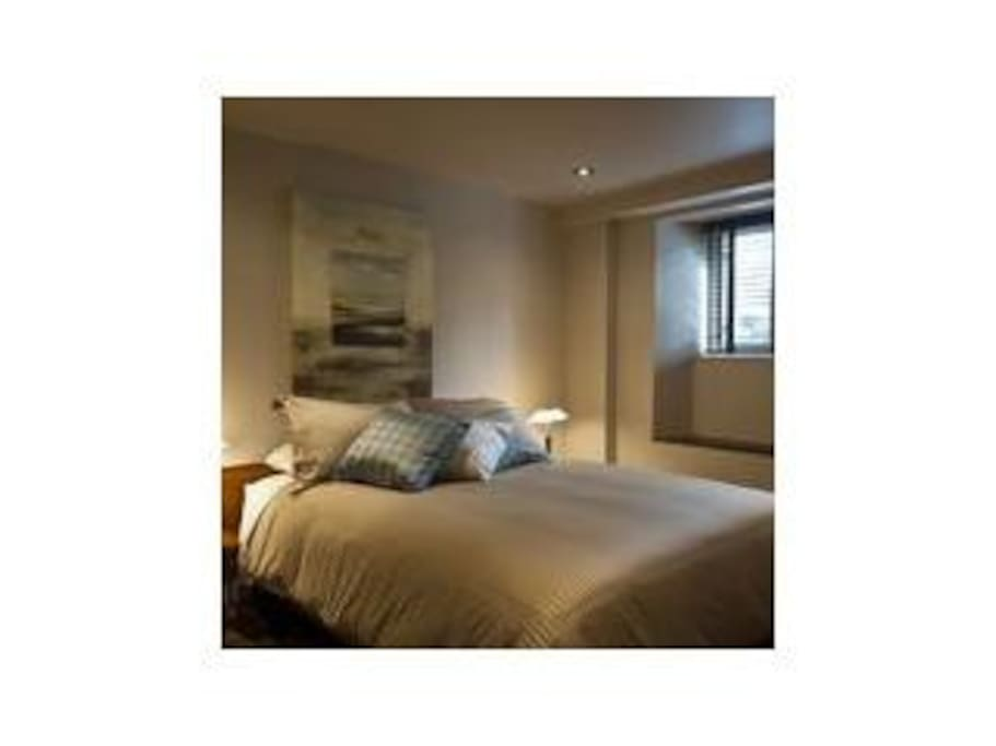 Pillow top queen bed, luxurious linens and teak furnishings.  Large dressing room adjacent