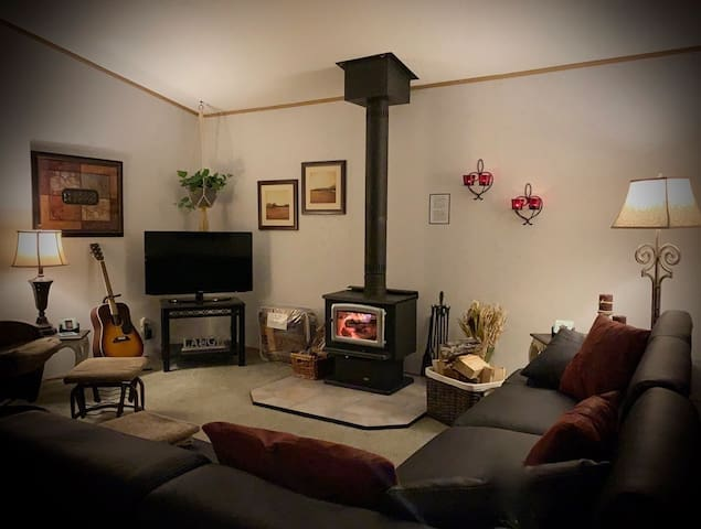 Cozy up around the wood burning stove and play some games, read a book, or enjoy a movie on the smart TV with Shaw satellite.
