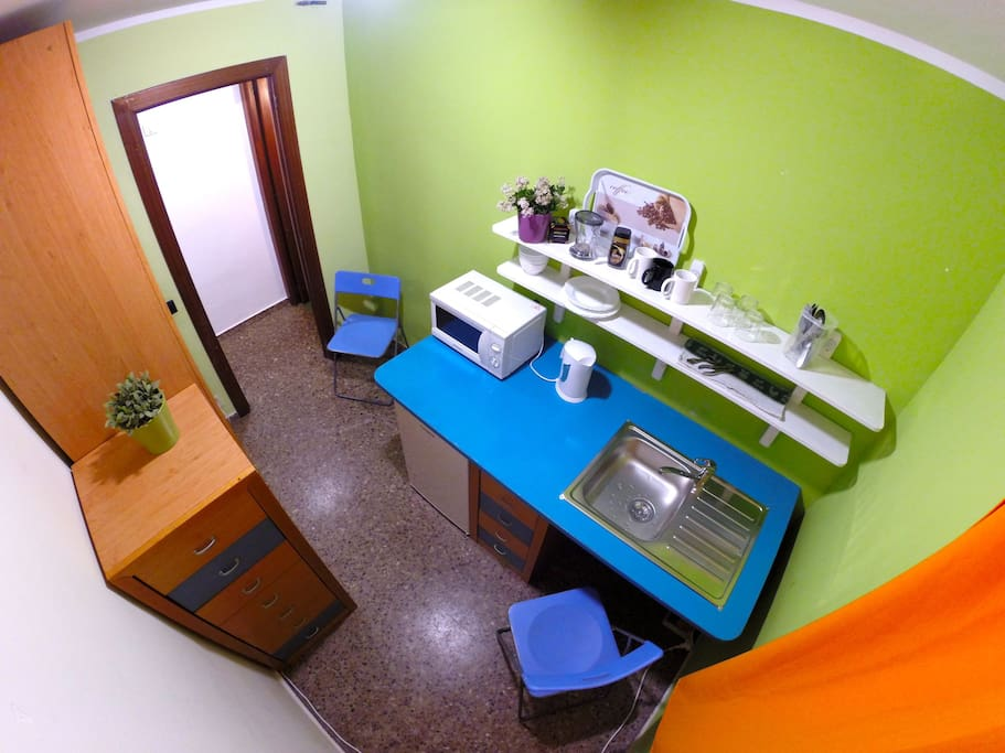 Colorful office room for guests equipped with fridge, microwave and kettle. And a small cooker! You can prepare your breakfast or light meals.