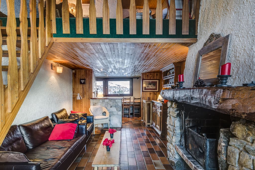 living room with fire place , open kitchen with table for 8