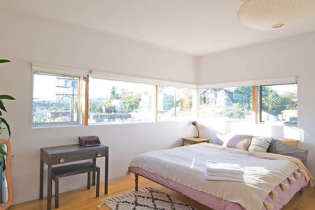 bedroom 1 offers panoramic views of the city, hollywood sign and observatory and king bed