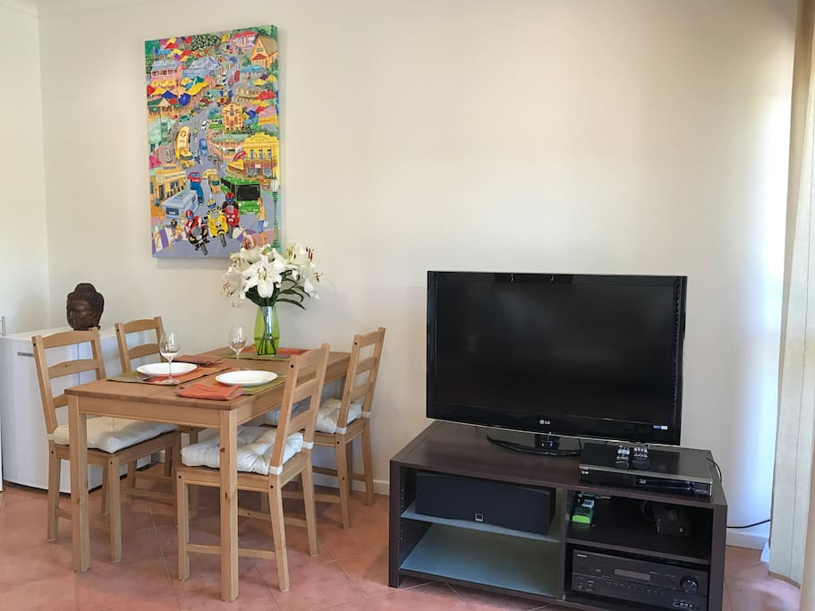 In-room dining, or work desk with large  HD television