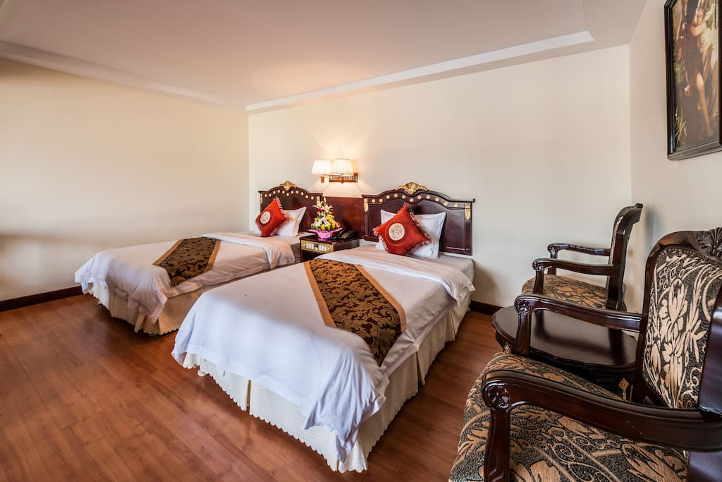 smiling private suite twin beds room