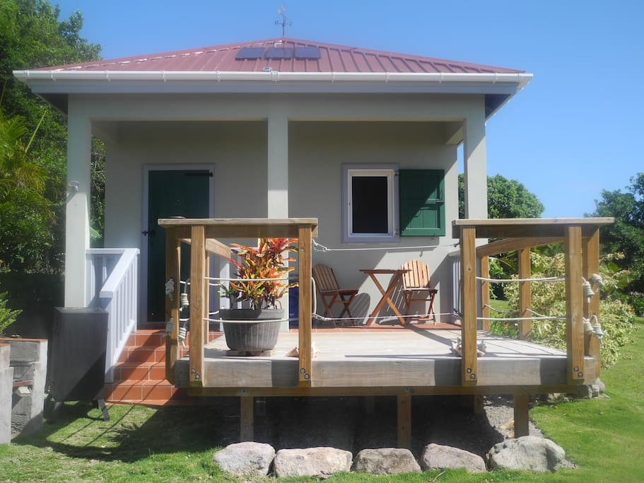 Wooden deck for sunning or star gazing, outdoor BBQ