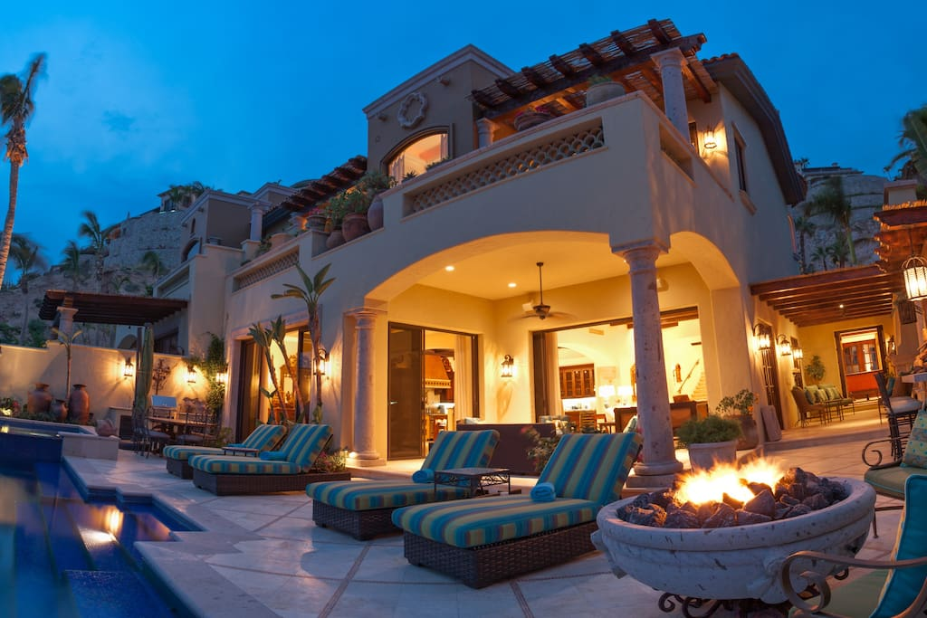 Massive outdoor living area with an infinity pool, hot spa, fire bowl, and outdoor dining.