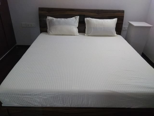 Bedroom no.1 -Super king size bed with Wakefit Orthopedic Memory Foam Mattress provided to allow you to sleep better without any backpain
