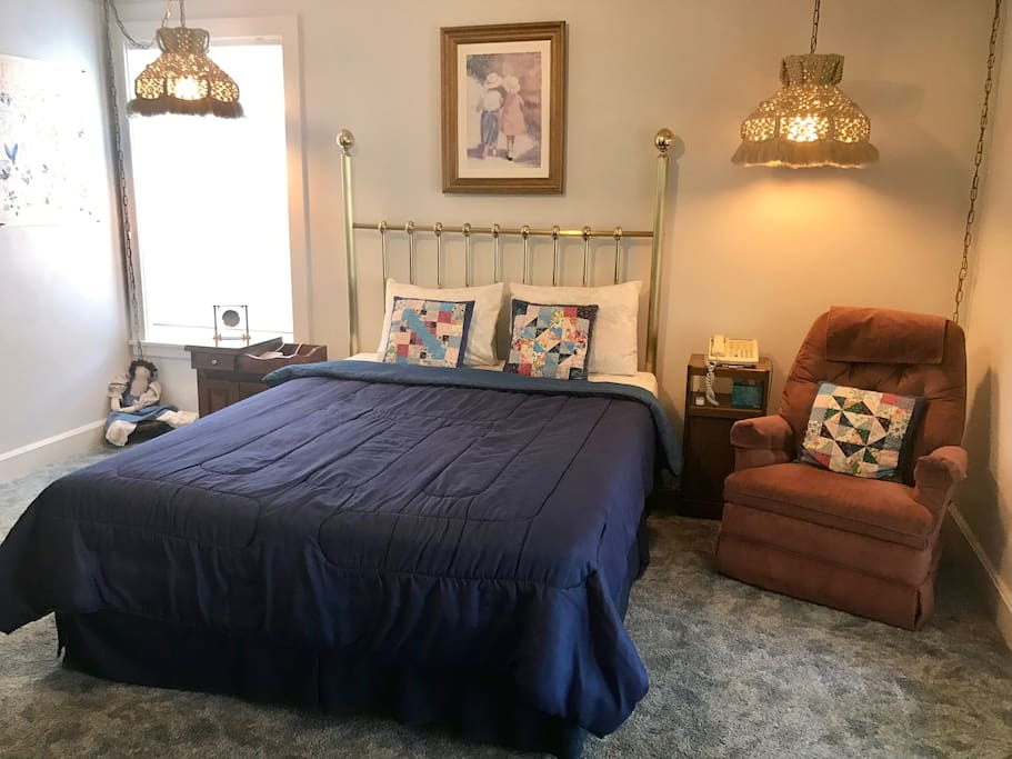 Comfortable queen size bed and recliner.