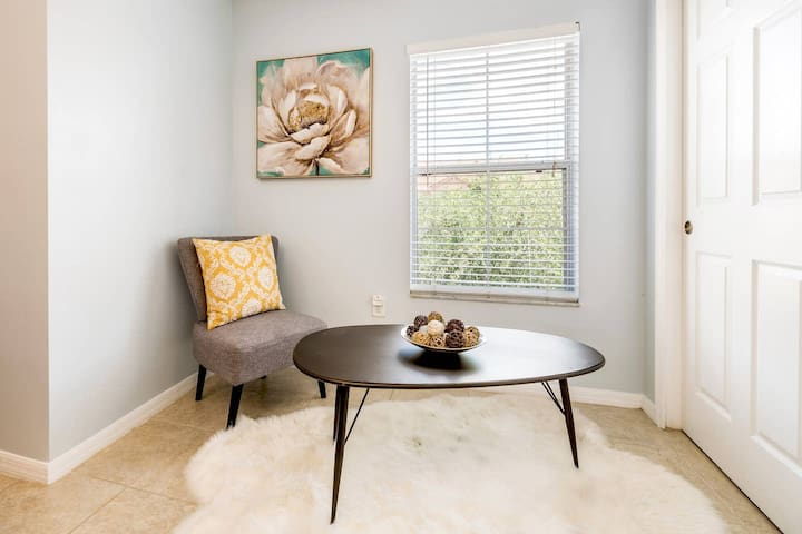 Master Bedroom - This charming seating area is a great spot to recharge your batteries.