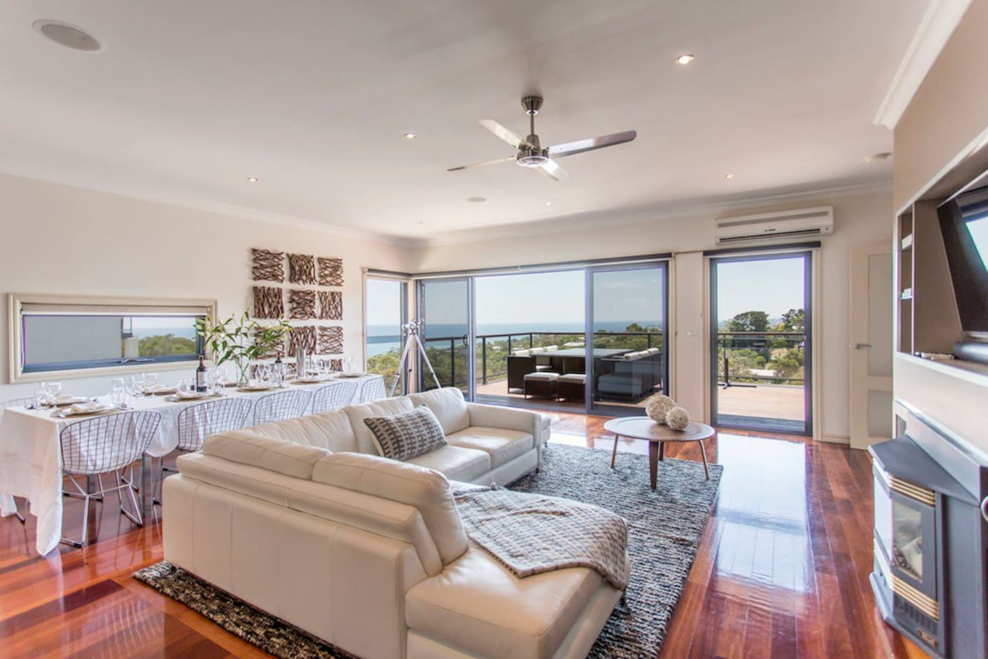 Level 1 Living Room. Comfy Leather Sofa, wool/silk throw rugs, Dining table seats up to 12, Smart TV, access directly onto verandah.
